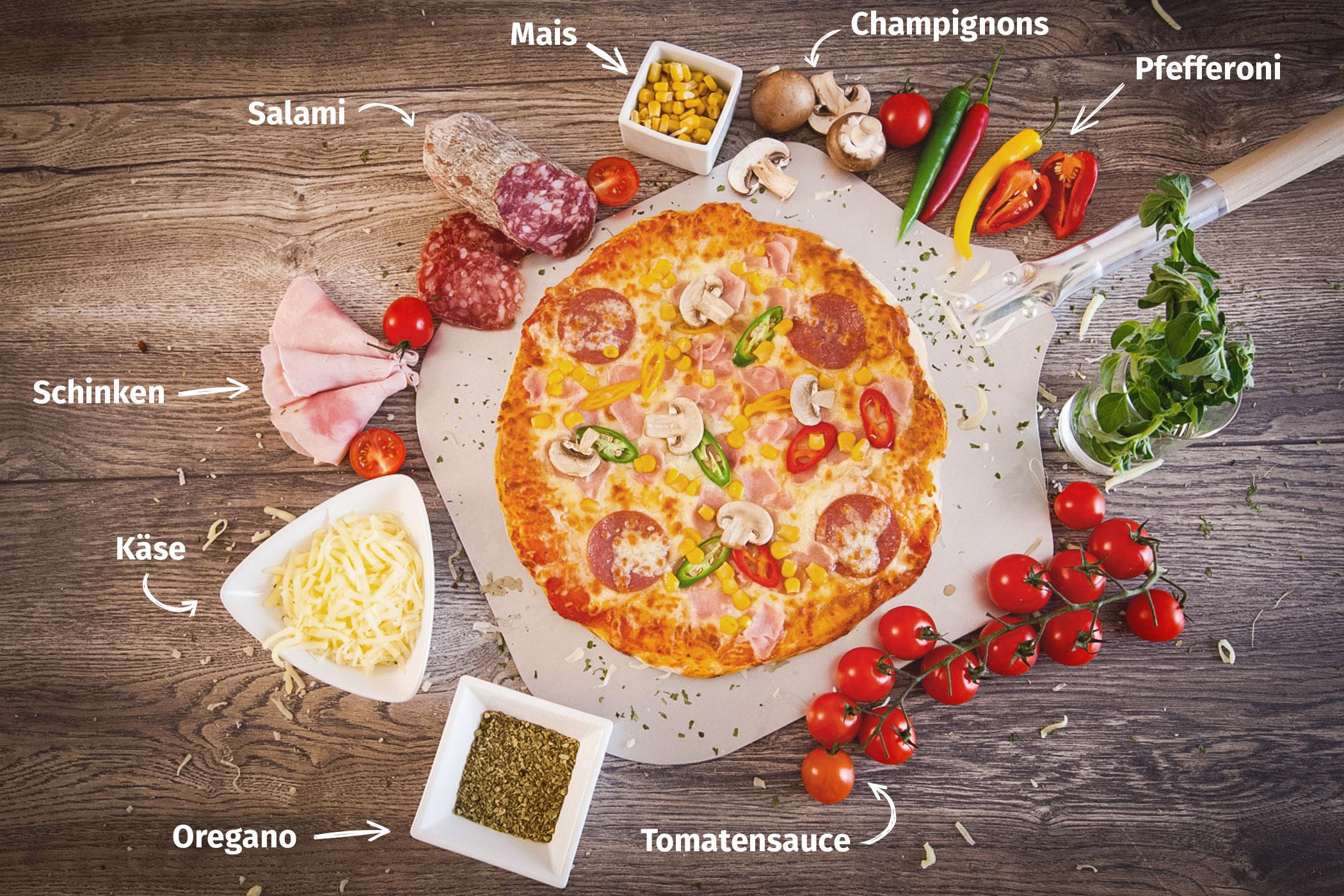 Original Franzesco Pizza Spezial belegt mit Tomatensauce, Schinken, Käse, Salami, Mais, Champigons und Oregano